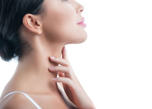 Woman with a sculpted chin after Kybella treatments