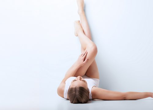 Woman with smooth legs after laser hair removal