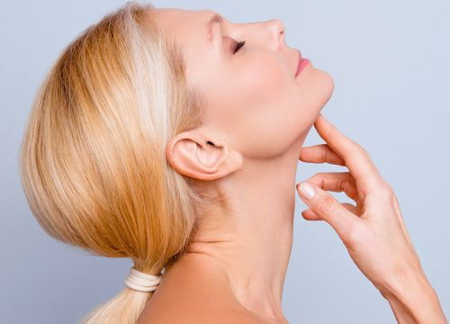 Woman looking up showing off her submentoplasty results