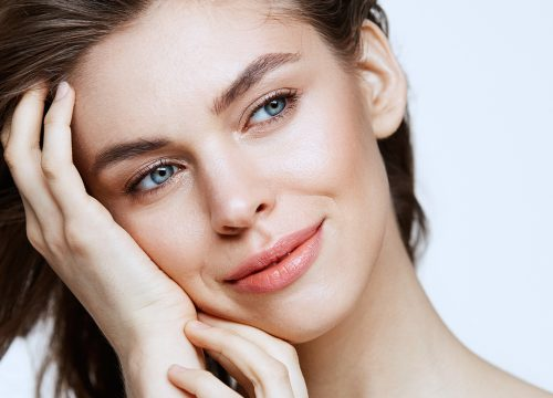 Woman with balanced face after receiving dermal fillers