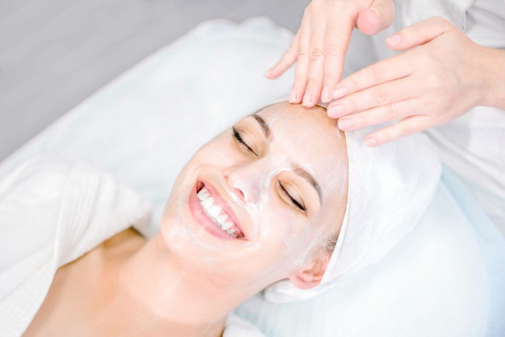Woman receiving a facial at a spa