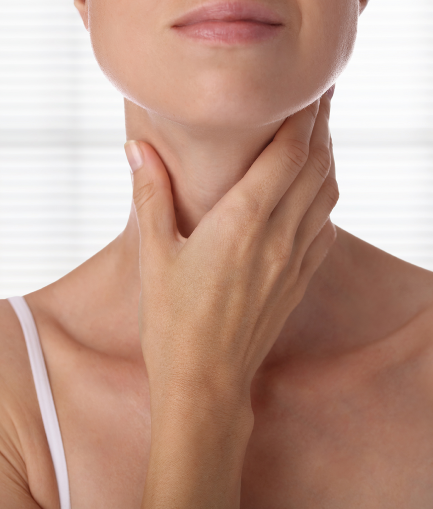 Woman touching her neck and jaw